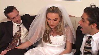 Horn-mad and cum voracious blonde bride works on two stiff dicks at once