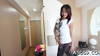 Asian cutie blows cock nicely
