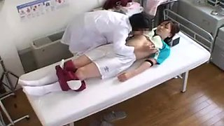 Naughty doctor gropes her lovely patient's tits while she's