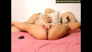 Flexible blonde chick masturbates her pussy