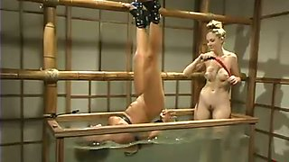 Veronika gets her pussy toyed in a box filled with water