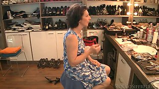 Brunette granny is poked upskirt from behind in POV