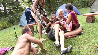 Kitty Jane and her hot friends like to suck a big cock outdoors
