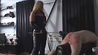 Leather Mistress Caning Hard.