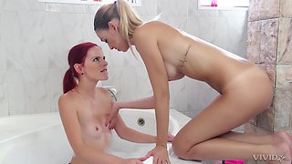 Strap on lesbian fuck in the bathtub with Erica Fontes and Susana Melo