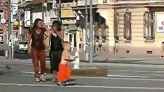 Drunken gypsy in the fountain on the street