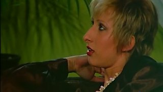 Short haired lovely blonde woman gives head and rides it on top