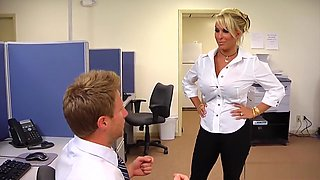 Big breasted milf boss Holly Halston fucks a younger guy in the office