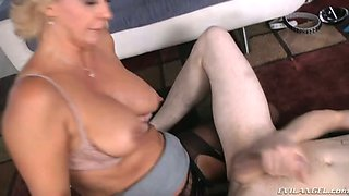Hot mommy Phyllisha Anne drills his ass hole with a strap on