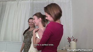 Two bride maids teaching bride good sucking skills