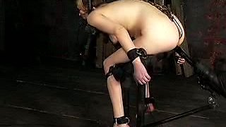 Hogtied blonde slave with a hook in her ass is suspended and punished