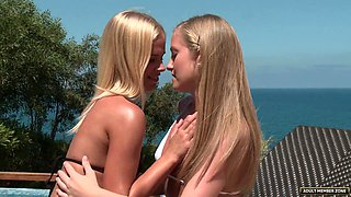 Awesome blonde lesbians like to please each other by the pool