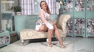 Pretty natural blonde shows it all off as teasing in nylons