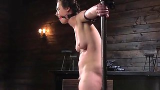 Zippered brunette slave gets pussy vibed