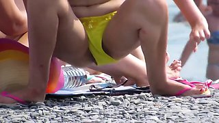 strange white woman sunbathes flashing ass in lowered bikini
