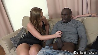 Swinger wife gives a hand job and blowjob to a black stud