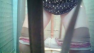 Pale skin lady filmed on hidden voyeur camera in the toilet
