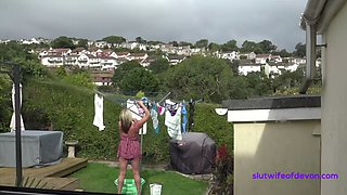 Sam hangs out the washing