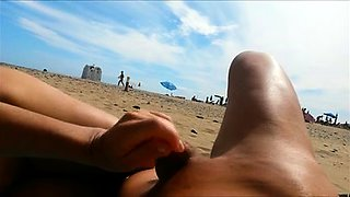 Amateur wife reveals her handjob skills on the beach in POV