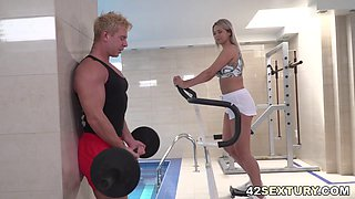 Blondie is enjoying her gym time with those well endowed fitness buddies