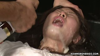 Several Asian dudes punish tied up Asian chick Eri Makino and cum in her pussy