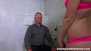 Young beautiful gal and old man are having sex in the toilet room