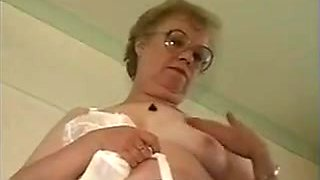 Granny In Glasses Shows Off Her Boobs