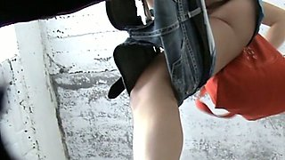 Pale skin booty of a stranger girl filmed from underneath in the toilet