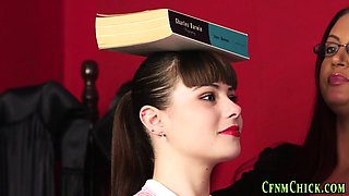 Clothed domina teaches
