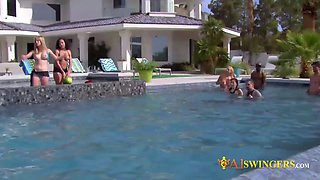Redhead couple mixes and mingles with other swingers by the pool