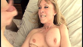 Big boobed blonde milf in stockings and a garter