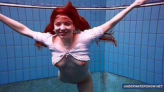 Amazing hairy under water show by redhead Marketa