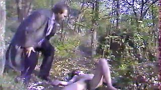 Slutty white girl gets banged by two guys in the forest
