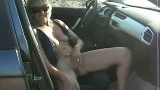 My depraved wife masturbates her coochie in a car on the way home