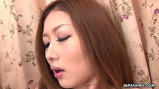 Sexy young Japanese babe in pink sleeping gown strips and masturbates