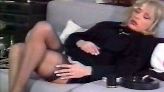 Mesmerizing blonde model feeling horny on the couch
