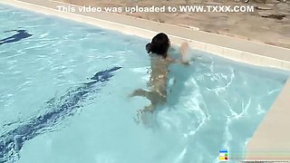Naughty Oriental girl Jenny shows off her fabulous body in the pool