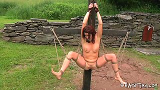 Sexy girl suspended outdoors is punished by her master