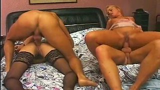 Black and blond haired cowgirls get their loose buttholes nailed hard