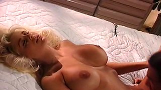 Sweet and busty classic blondie eating dick of a big guy