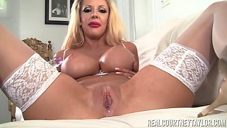 Gorgeous blonde Courtney Taylor has a blast with her toy
