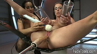 Lesbians finger and toy pussys with machine