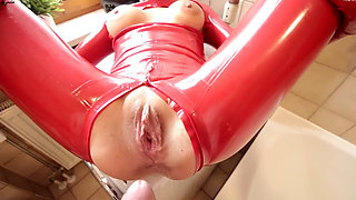 daynia in red latex catsuit