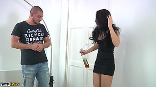 Sexy and drunk brunette has no idea that there are three men