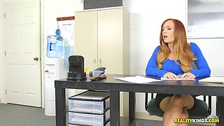 Redhead cougar with nice ass having her tight pussy throbbed in office