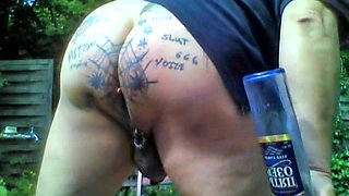 Tattooed XXl-Asshole in the garden