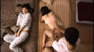 Sexy Oriental babe gets pounded hard while her sister sleeps