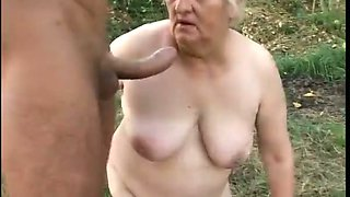 Brutal guy in mask fucks super fat ugly granny in woods hard
