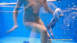 Cute Lucie is stripping underwater