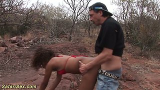 Wild African bitch enjoys riding a big white dick outdoor